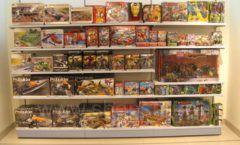 Торговое оборудование отдела игрушек магазина Винни ТЦ Юнимолл ЦВЕТНЫЕ МЕТАЛЛИЧЕСКИЕ СТЕЛЛАЖИ Фото 09