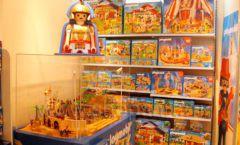 Торговое оборудование отдела игрушек магазина Винни ТЦ Юнимолл ЦВЕТНЫЕ МЕТАЛЛИЧЕСКИЕ СТЕЛЛАЖИ Фото 10