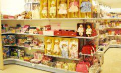 Торговое оборудование отдела игрушек магазина Винни ТЦ Юнимолл ЦВЕТНЫЕ МЕТАЛЛИЧЕСКИЕ СТЕЛЛАЖИ Фото 15