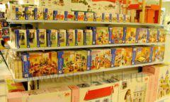 Торговое оборудование отдела игрушек магазина Винни ТЦ Юнимолл ЦВЕТНЫЕ МЕТАЛЛИЧЕСКИЕ СТЕЛЛАЖИ Фото 17