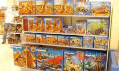 Торговое оборудование отдела игрушек детского магазина Винни ТЦ Юнимолл ЦВЕТНЫЕ МЕТАЛЛИЧЕСКИЕ СТЕЛЛАЖИ Фото 11