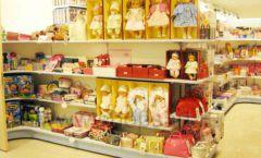 Торговое оборудование отдела игрушек детского магазина Винни ТЦ Юнимолл ЦВЕТНЫЕ МЕТАЛЛИЧЕСКИЕ СТЕЛЛАЖИ Фото 15