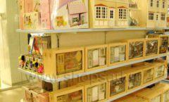 Торговое оборудование отдела игрушек детского магазина Винни ТЦ Юнимолл ЦВЕТНЫЕ МЕТАЛЛИЧЕСКИЕ СТЕЛЛАЖИ Фото 18