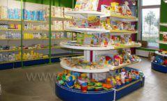 Торговое оборудование магазина в Green park ЦВЕТНЫЕ МЕТАЛЛИЧЕСКИЕ СТЕЛЛАЖИ Фото 10